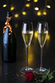 Closeup Of A Pair Of Wine Glasses, Dinning And Night Life Concept. A Pair Of Glasses Of Champagne Wi poster