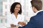 Smiling African Hr Manager Handshake Hire Candidate At Job Interview poster