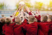 Golden Trophy Raise. Children Soccer Team Raising Golden Winning Football Trophy. Sports Success Of  poster
