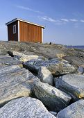 Cabin On A Stone Beach