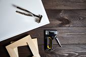 Stretching White Canvas On Wooden Stretcher Bar, Staple Gun And Canvas Pliers On A Brown Table poster