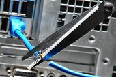 Scissors Cutting A Computer Ethernet Network Cable