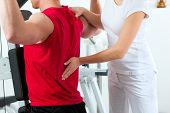 foto of physiotherapy  - Patient at the physiotherapy making physical exercises with his therapist - JPG