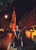 Luxury Woman In Evening Dress At Night City Go To Prom On Taxi. Girl With Glamour Makeup. Night City poster