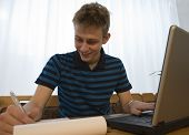 Young Man Doing Homework
