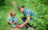 Little Boy And Father In Nature Background. Gardening Tools. Gardening Hobby. Dad Teaching Little So poster