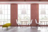 Side View Of Bright Pink Cafe Interior poster