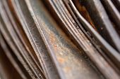 Picturesque Curved Sheets Of Rusty Metal. Curved Rusty Sheets Of Metal. Industrial Abstraction. poster