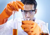 pic of chemical reaction  - Asian scientist mixing chemical in laboratory shot in studio - JPG
