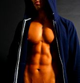 Fit Male in a Hooded Sweater