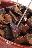 closeup of a plate with sauteed rovellones, typical autumn mushrooms of Spain