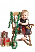 Happy Christmas Baby With Gifts Rocks In Patchwork Dress