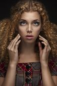 young beautiful doll girl with curly hair
