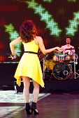 Beautiful girl in yellow dress sings a very catchy song