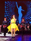 Woman singing onstage