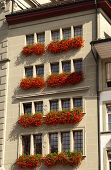 Apartment house with red Geraniums in flower boxes