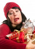 Attractive Woman Fumbling with Her Holiday Gifts Isolated on a White Background.