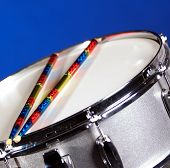 Silver Sparkle Snare Drum Ans Sticks On Blue