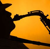 Saxophone Player In Silhouette On Gold
