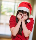 excited christmas woman with her eyes shut, indoor