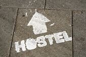 Hostel Sign On The Ground