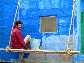 JODHPUR - OCTOBER 29. Indian man painting his house in blue on October 29, 2004 in Jodhpur, India. J