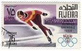 Running Skater At The Winter Olympics In Grenoble On Postage Stamp