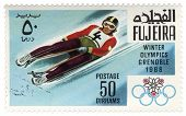 Descent To Sledge At The Winter Olympics In Grenoble On Postage Stamp