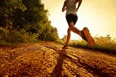 picture of cross hill  - Young lady running on a rural road - JPG