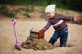 stock photo of treasure  - little funny girl hunting for treasure - JPG