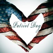stock photo of state shapes  - patriot day written in the blank space of a heart sign made with the hands patterned with the colors and the stars of the United States flag - JPG