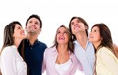 Happy group of people looking up - isolated over white background