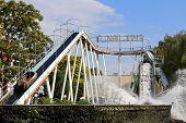 VIENNA, AUSTRIA - AUGUST, 10 : Danube Jump (Donau-Jump), Water game in a hollowed trunk at Wiener Prater, Prater Amusement Park on August 10, 2012