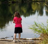 Young Girl Looking Where To Fish On Lake