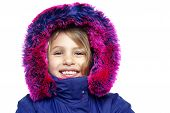 stock photo of eskimos  - Face closeup of a beautiful female child in eskimo jacket white background - JPG