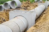 stock photo of manhole  - Concrete drainage pipe and manhole under construction - JPG
