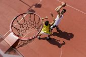 image of basketball  - Basketball players playing basketball on the court - JPG