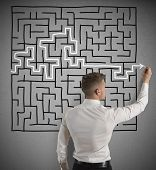 foto of maze  - Businessman finding the solution of a maze - JPG
