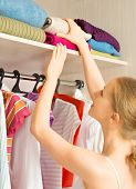 Woman Chooses Clothes In The Wardrobe Closet At Home
