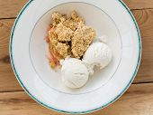 Traditional British Apple Crumble Pie In Dish With Ice Cream