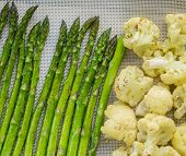Cauliflower And Asparagus Being Roasted In Oven