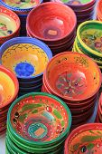stock photo of pottery  - pottery in traditional provencal colors and patterns at a market in the provence - JPG