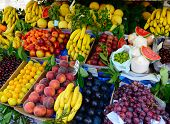 stock photo of plum fruit  - Fruits and vegetables at a farmers market - JPG