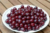 Fresh Cherries On White Plate