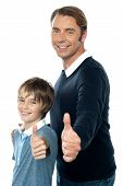 Confident Father And Son Duo Gesturing Thumbs Up