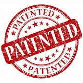image of plagiarism  - patented red grunge round stamp on white background - JPG