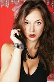 Fashion Glamour Girl With Jewellery On Red Vintage Background