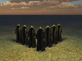 stock photo of hoods  - Hooded figures in barren landscape - JPG
