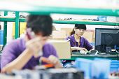 stock photo of assemblage  - female chinese worker woman assembling production at line conveyor in china factory manufacturing - JPG
