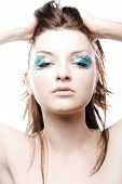 Beautiful Young Woman Wearing Sparkly Make-up On White